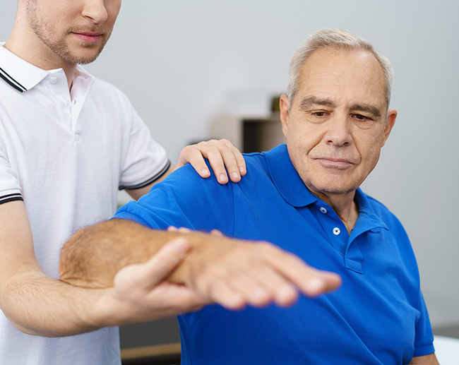 Senior man receiving physiotherapy treatment